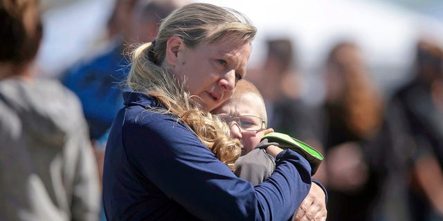 People embrace after a school shooting at Rigby Middle School in Rigby, Idaho, on Thursday. (John Roark/The Idaho Post-Register via AP)