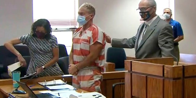 In this still image from video, Barry Morphew, center, appears in court in Salida, Colo., Thursday, May 6, 2021. Morphew was arrested on Wednesday, May 5, in connection with the disappearance of his wife, Suzanne Morphew, who was last seen a year ago on Mother's Day, May 10, 2020.