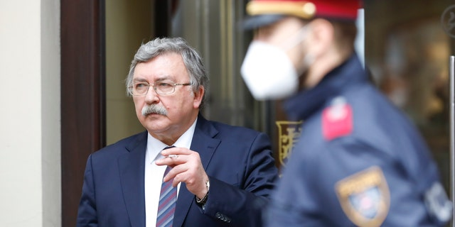 Russia's governor to the International Atomic Energy Agency (IAEA), Mikhail Ulyanov, has a cigarette break outside of the Grand Hotel Wien, where closed-door nuclear talks with Iran take place in Vienna, Austria, Friday, May 7, 2021. (AP Photo/Lisa Leutner)