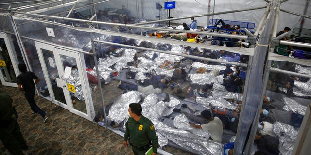 In this March 30, 2021 file photo, minors lie inside a pod at the Donna Department of Homeland Security holding facility, the main detention center for unaccompanied children in the Rio Grande Valley run by U.S. Customs and Border Protection (CBP), in Donna, Texas. (AP Photo/Dario Lopez-Mills,Pool, File)