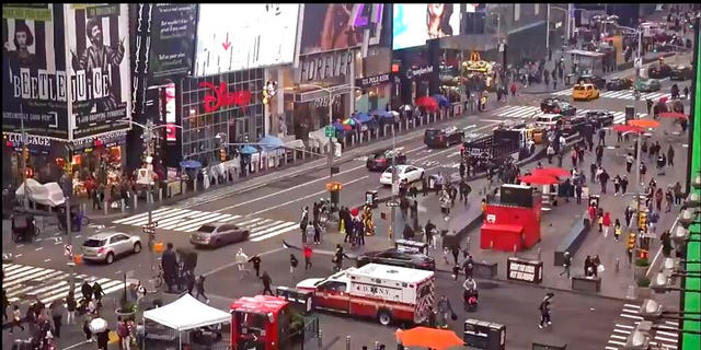 In this image taken from video by the FDNY, pedestrians hurry away from the scene of a shooting in Times Square, Saturday, May 8, 2021, in New York. (FDNY via AP)