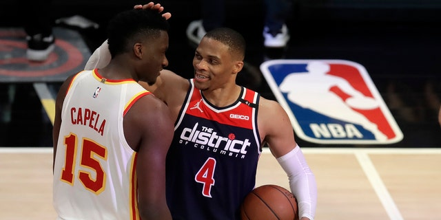 Washington Wizards' Russell Westbrook (4) is congratulated by Atlanta Hawks' Clint Capela at the end of an NBA basketball game Monday, May 10, 2021, in Atlanta. (AP Photo/Ben Margot)