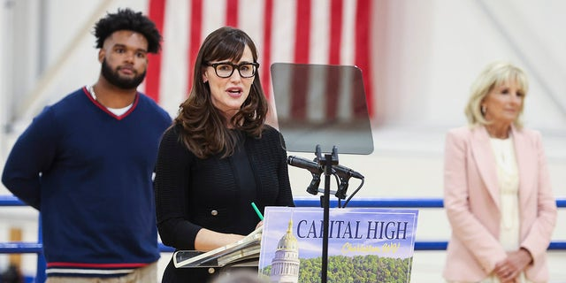 Actress Jennifer Garner speaks during a visit with first lady Jill Biden to a vaccination center at Capital High School in Charleston, W.Va., Thursday, May 13, 2021. (Oliver Contreras/The New York Times via AP, Pool)