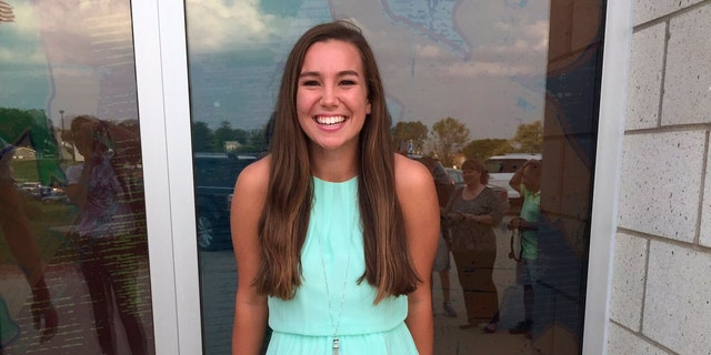 FILE - In this September 2016 file photo provided by Kim Calderwood, Mollie Tibbetts poses for a picture during homecoming festivities at BGM High School in her hometown of Brooklyn, Iowa. Video evidence, DNA analysis and a partial confession will be critical to proving Cristhian Bahena Rivera, a farm laborer, stabbed Tibbetts, a University of Iowa student, to death while she was out for a run in 2018, a prosecutor told jurors Wednesday, May 19, 2021. (Kim Calderwood via AP, File)