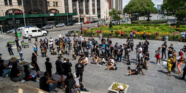 People attend a rally with Terrence Floyd, brother of George Floyd, on Sunday, May 23, 2021, in Brooklyn borough of New York. (AP Photo/Eduardo Munoz Alvarez)