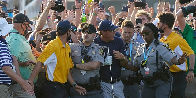 Phil Mickelson tries to get through the crowd during the final round at the PGA Championship golf tournament on the Ocean Course, Sunday, May 23, 2021, in Kiawah Island, S.C. (AP Photo/Matt York)