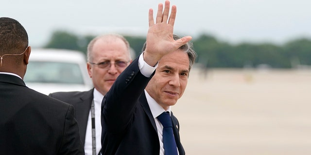 Secretary of State Antony Blinken waves as he departs, Monday, May 24, 2021, at Andrews Air Force Base, Md. Blinken said Tuesday that the United States will continue its effort to rejoin the Iran nuclear deal over Israeli objections. (AP Photo/Alex Brandon, Pool)