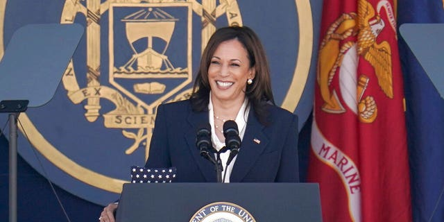Vice President Kamala Harris delivers a speech at the graduation and mandate ceremony at the US Naval Academy in Annapolis, Maryland, Friday, May 28, 2021. (AP photo/Julio Cortez)