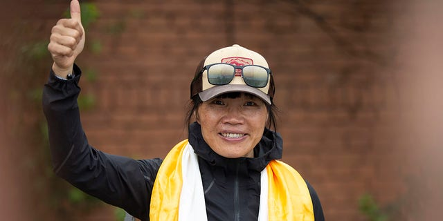 Tsang Yin-hung, 45, from Hong Kong, climbed Everest from a base camp in 25 hours and 50 minutes and became the fastest female climber. (AP Photo/Bikram Rai)