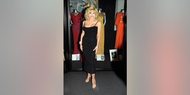Loni Anderson wearing Marilyn Monroe's original dress at The Hollywood Museum.