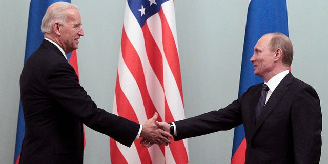 Russian Prime Minister Vladimir Putin (R) shakes hands with U.S. Vice President Joe Biden during their meeting in Moscow March 10, 2011. Biden is on the second day of an official visit meeting top officials in the Russian capital. REUTERS/Alexander Natruskin (RUSSIA - Tags: POLITICS)