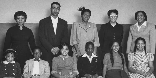 Portrait of the African-American students for whom the famous Brown vs Board of Education case was brought and their parents: (front row L-R) Vicki Henderson, Donald Henderson, Linda Brown, James Emanuel, Nancy Todd, and Katherine Carper; (back row L-R) Zelma Henderson, Oliver Brown, Sadie Emanuel, Lucinda Todd, & Lena Carper, Topeka, Kansas, 1953. (Photo by Carl Iwasaki/The LIFE Images Collection via Getty Images/Getty Images)