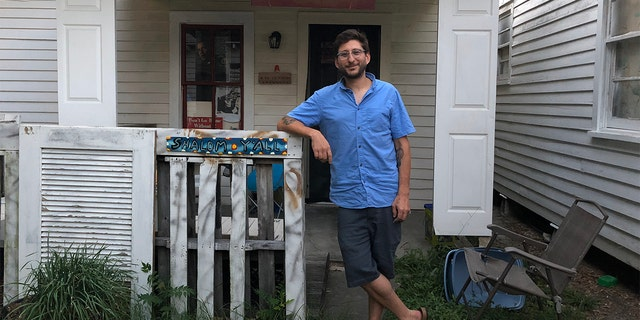 Journalist Danny Fenster, 37, is pictured in June 2018 outside his house in Lafayette, LA.