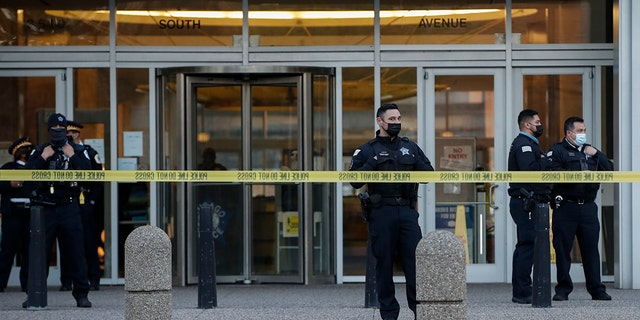 Chicago Police officers guard the front entrance the their headquarters building during a rally on April 15, 2021 in Chicago, Illinois. (Kamil Krzaczynski/Getty Images)