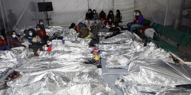 This image shows packed migrants in Donna, Texas in March.