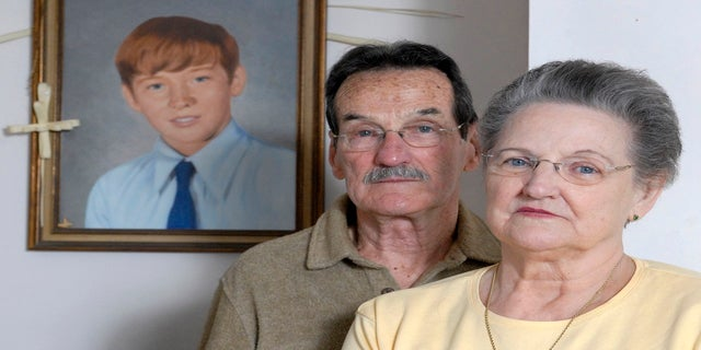 Carl and Bunny Croteau stand in front of a portrait of their murdered son, Danny, in their Springfield, Massachusetts home in this Feb. 26, 2008 file photo. (AP)