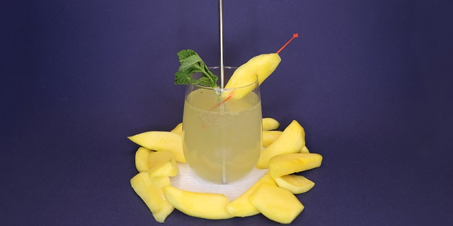 The Hawaii Mango Mint French 75 is mixed with pickled mangos, mint, gin, sugar and prosecco. (Cortney Moore/Fox News)