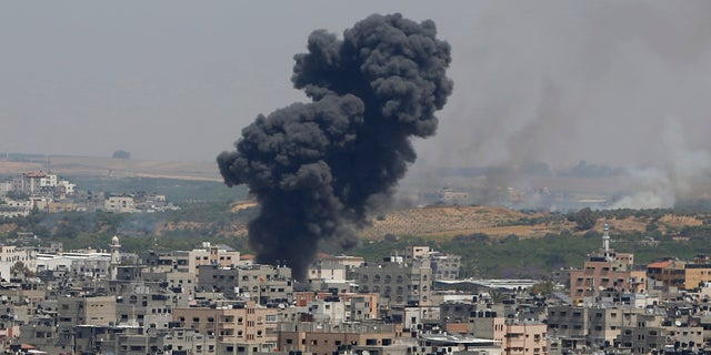 Smoke rises after an Israeli airstrike in Gaza in Gaza City on Tuesday. (AP)