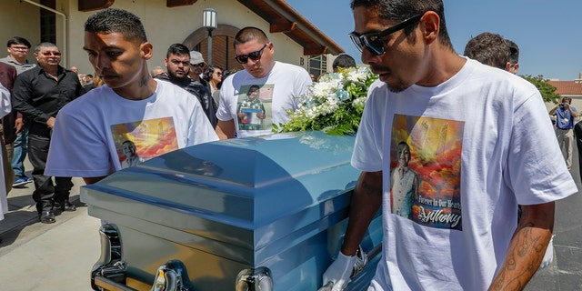Victor Avalos, right, father of Anthony Avalos, and other family members bring the coffin out after funeral services at the Saint Junipero Serra Ward on July 20, 2018 in Quartz Hills, California.  (Getty Images)