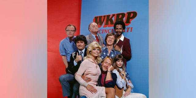Pictured left to right: Richard Sanders (as news director Les Nessman), Frank Bonner (as advertising salesman Herb Tarlek), Loni Anderson (as receptionist Jennifer Marlowe), Gordon Jump (as general manager Arthur 'Big Guy' Carlson), Howard Hesseman (as morning disk jockey Dr. Johnny Fever), Gary Sandy (as radio program director Andy Travis), Jan Smithers (as assistant and traffic coordinator Bailey Quarters) and Tim Reid (as nighttime disc jockey Venus Flytrap) star on WKRP in Cincinnati, a CBS television situation comedy about characters at a radio station. Originally broadcast September 18, 1978.