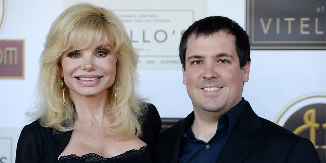 Loni Anderson and her son Quinton Anderson Reynolds arrive at the debut of the Southern California location of Michael Feinstein's new supper club Feinstein's at Vitello's on June 13, 2019, in Studio City, California.