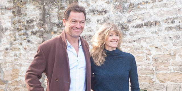 Dominic West and wife Catherine FitzGerald make a statement to press outside their Cotswolds home after Dominic was seen kissing actress Lily James whilst in Rome on October 13, 2020, in Cotswolds, England.