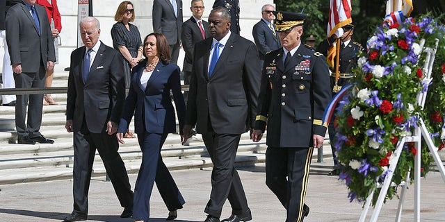 President Biden, Vice President Kamala Harris, Defense Secretary Lloyd Austin and Chairman of Joint Chiefs of Staff General Mark Milley arrive to take part in a wreath-laying in front of the Tomb of the Unknown Soldier at Arlington National Cemetery on Memorial Day in Arlington, Va., on May 31, 2021.