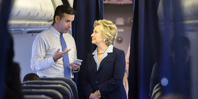 Hillary Clinton with then-spokesman Brian Fallon on her plane at Westchester County Airport in New York, in 2016.