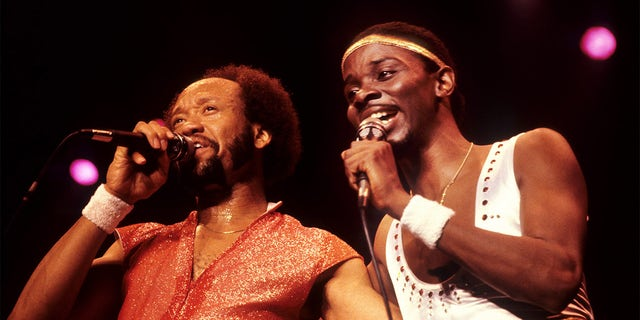 Maurice White and Philip Bailey performing on stage together.