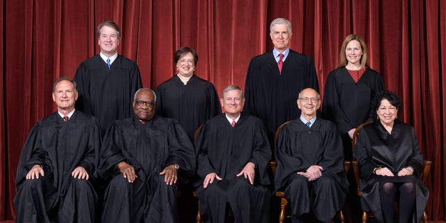The Roberts Court, April 23, 2021. Seated from left to right: Justices Samuel A. Alito, Jr. and Clarence Thomas, Chief Justice John G. Roberts, Jr., and Justices Stephen G. Breyer and Sonia Sotomayor. Standing from left to right: Justices Brett M. Kavanaugh, Elena Kagan, Neil M. Gorsuch, and Amy Coney Barrett. Kavanaugh was absent at the first day of the 2021-2022 term due to a case of COVID-19. (Photograph by Fred Schilling, Collection of the Supreme Court of the United States)