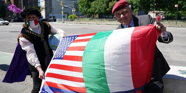 A man dressed as Christopher Columbus and mayoral candidate Curtis Sliwa hold a flag, as Italian American community groups hold a demonstration in Columbus Circle in New York on May 12, 2021 in support of Italian Heritage and Columbus Day.