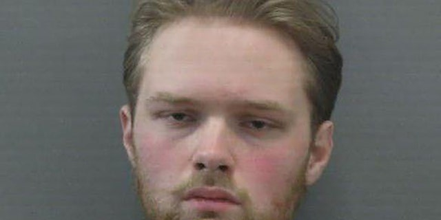 Joseph Thomas Ness, 21, was taken into custody without incident.