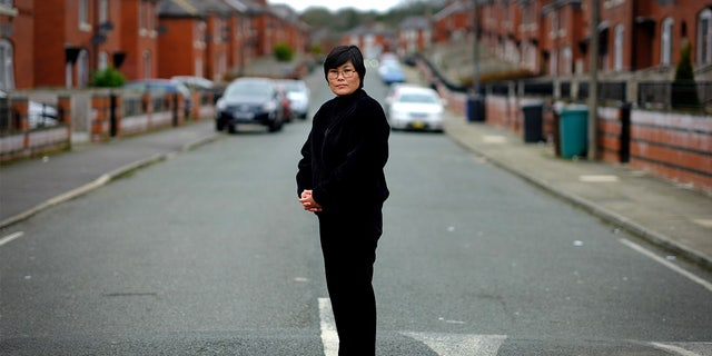 Jihyun Park, who fled North Korea before settling in Britain, poses for a photograph after deciding to stand for election as a Conservative party candidate in the upcoming local elections in the Moorside Ward in Bury, Britain.