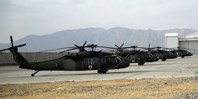 Black Hawk helicopters on display during an air show at Kandahar Airfield in 2018. (AP Photo/Massoud Hossaini, File)