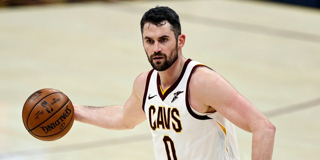 FILE - In this April 30, 2021, file photo, Cleveland Cavaliers' Kevin Love (0) dribbles against the Washington Wizards during the first half of an NBA basketball game in Cleveland. (AP Photo/Ron Schwane, File)