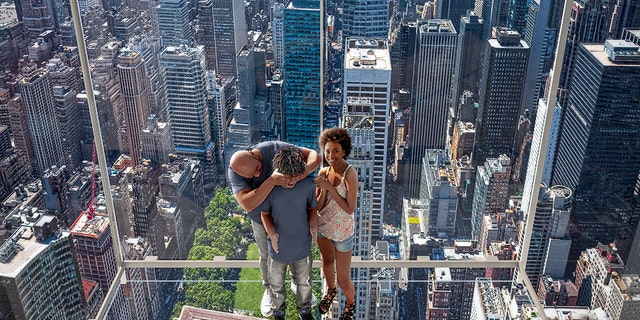 The see-through human dumbwaiter, called Ascent, will take riders up to 1,210 feet above the city, where they can gaze down upon Madison Avenue.
