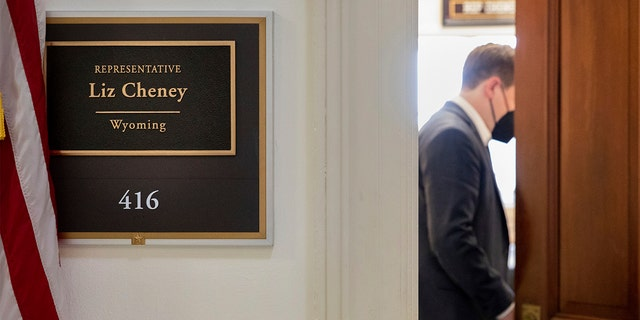 A person closes the door of Rep. Liz Cheney's, R-Wyo., office on Capitol Hill in Washington, Tuesday, May 11, 2021. (AP Photo/Amanda Andrade-Rhoades)