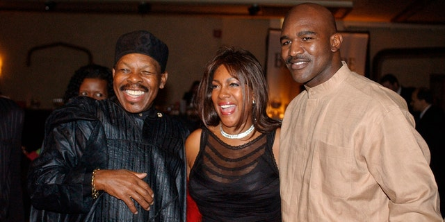 """In this Feb. 20, 2003 file photo, Lloyd Price, left, and Mary Wilson, of the Supremes, pose for a photograph with boxer Evander Holyfield during the reception of the 13th Annual Pioneer Awards presented by the Rhythm & Blues Foundation in New York. The New Orleans mainstay and Rock and Roll Hall of Famer has died. Price was known for such hits as """"Lawdy Miss Clawdy"""" and """"Stagger Lee."""" His wife Jackie said he died Monday, May 3, 2021 in New Rochelle, N.Y."""