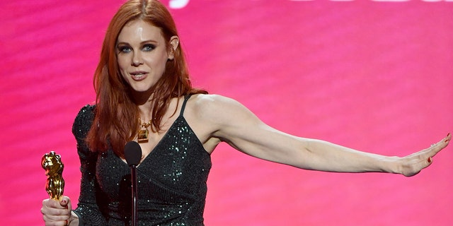 Maitland Ward accepts the award for best-supporting actress during the 2020 Adult Video News Awards.