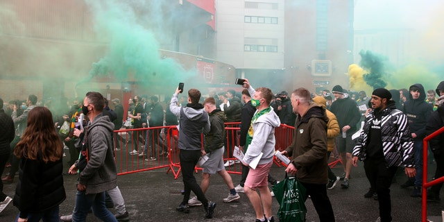 Fans make their way into the ground as they protest against the Glazer family, owners of Manchester United, before their Premier League match against Liverpool at Old Trafford, Manchester. Issue date: Sunday May 2, 2021.
