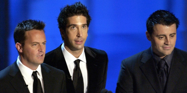 Matthew Perry (left) on stage at the Emmys in 2003 with his fellow 'Friends' stars David Schwimmer (center) and Matt LeBlanc (right) to present the award for outstanding supporting actress in a comedy series. (Photo by Ray Mickshaw/WireImage)