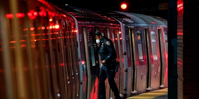 A Metopolitan Transportation Authority (MTA) police officer looks for passengers at the last stop at the Coney Island station in Brooklyn, New York on May 6, 2020.