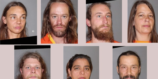 The seven people who have been charged in connection with the discovery of a mummified body.