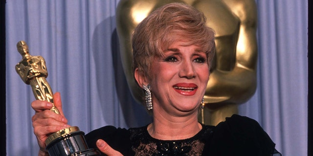 Actress Olympia Dukakis holds her Best Actress in a Supporting Role Oscar for 'Moonstruck' at the Academy Awards April 11, 1988, in Los Angeles, CA.