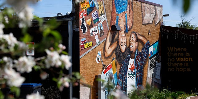This photo shows a mural painted on the outside wall of Gibbs-Morrison Cultural Center in the 5th Ward of Evanston, Ill., Thursday, April 29, 2021.