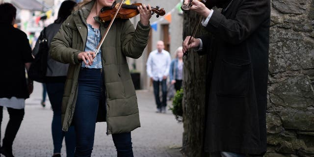 Rose Reid and Patrick Bergin play traditional Irish music in 'Finding You.'