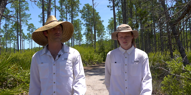 David Bulger (left) walking alongside Justin Moore through the Panama City Beach Conservation Park (Robert Sherman, Fox News).