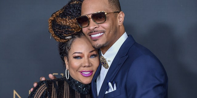 """Tameka """"Tiny"""" Cottle and T.I. attend the 51st NAACP Image Awards at the Pasadena Civic Auditorium on February 22, 2020, in Pasadena, Calif. (Photo by Aaron J. Thornton/FilmMagic)"""