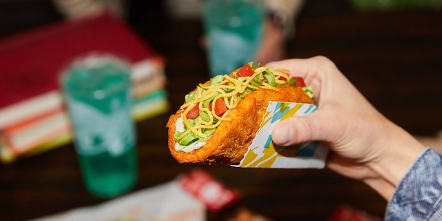 """The Naked Chicken Chalupa was first introduced by Taco Bell in 2017 and is returning to menus on Thursday as the fast food chain's entrance to the """"chicken sandwich wars."""""""
