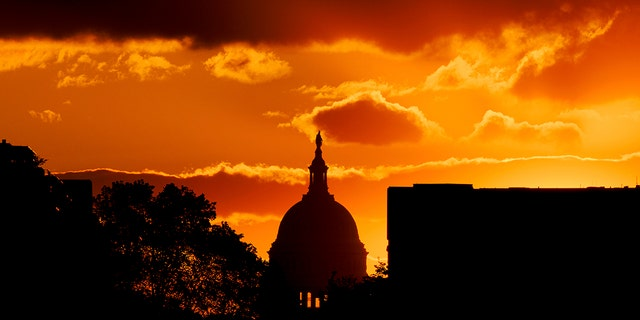 The U.S. Capitol Dome is silhouetted against the rising sun, Friday, April 30, 2021 in Washington. (AP Photo/J. David Ake)